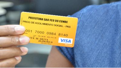 Novos beneficiários do PAS receberam cartão para retirada do benefício nesta sexta-feira (25)